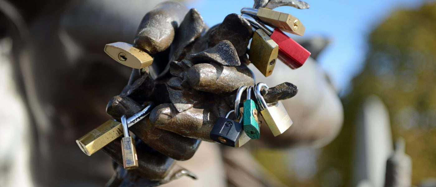 a fistful of padlocks representing authentication protocols